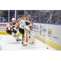 Lehigh Valley Phantoms goaltender Carter Hart handles a puck behind the net