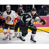 Tyler Wotherspoon of the San Antonio Rampage races for a puck with the Stockton Heat's Andrew Mangiapane