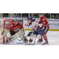 Saginaw Spirit right wing Jake Goldowski sets up in front of the Guelph Storm net