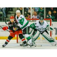 Texas Stars goaltender Landon Bow and defenseman Dillon Heatherington try to keep the Grand Rapids Griffins at bay