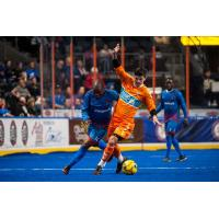 Leo Gibson of the Kansas City Comets (left) challenges a member of the Florida Tropics