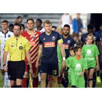 Defender Connor Tobin enters the pitch with North Carolina FC