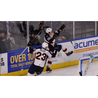 Kamerin Nault and Michael Pelech of the Greenville Swamp Rabbits celebrate Nault's game-winning goal against the Atlanta Gladiators