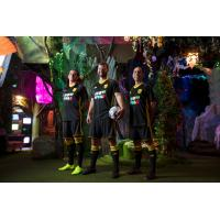 New Mexico United model the Meow Wolf jerseys