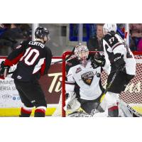 Vancouver Giants goaltender David Tendeck stops a Prince George Cougars' shot