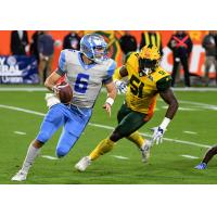 Salt Lake Stallions quarterback Josh Woodrum Evades the Arizona Hotshots' pass rush