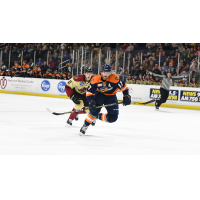 Greenville Swamp Rabbits forward Austen Brassard races the Atlanta Gladiators up the ice