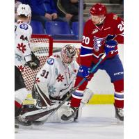 Vancouver Giants goaltender Trent Miner smothers a Spokane Chiefs' shot attempt