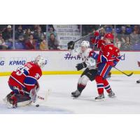 Bowen Byram of the Vancovuer Giants takes a shot against the Spokane Chiefs