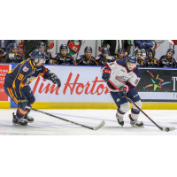 Saginaw Spirit left wing Cole Perfetti (right) against the Barrie Colts