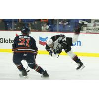 Vancouver Giants centre Justin Sourdif goes airborne against the Kamloops Blazers