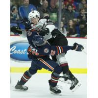 Vancouver Giants defenceman Kaleb Bulich delivers a hit against the Kamloops Blazers