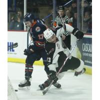 Vancouver Giants center Jadon Joseph (right) fights for the puck against the Kamloops Blazers