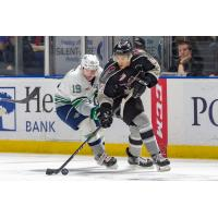 Justin Sourdif of the Vancouver Giants controls the puck against the Seattle Thunderbirds
