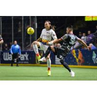 Victor Quiroz of the Ontario Fury (right) battles for possession against the Tacoma Stars