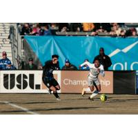 Sacramento Republic FC defender Shannon Gomez (right) sprints for the ball against the Colorado Springs Switchbacks