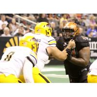 Arizona Rattlers DL Lance McDowdell (right) against the Tucson Sugar Skulls