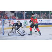 Conor Riley of the Adirondack Thunder sets up in front of the Newfoundland Growlers goal