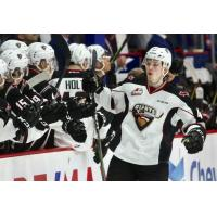 Vancouver Giants defenceman Bowen Byram receives congratulations from the bench