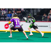 Saskatchewan Rush forward Ben McIntosh attacks the San Diego Seals