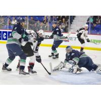 Jadon Joseph of the Vancouver Giants (center) tries to get off a shot against the Seattle Thunderbirds