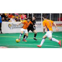 Mississauga MetroStars' Sebastian Lopez is challenged by the Baltimore Blast