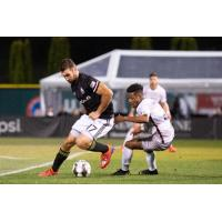 Tacoma Defiance forward Will Bruin (left) fights for possession against Sacramento Republic FC