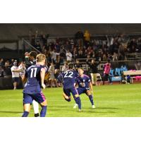 South Georgia Tormenta FC celebrates a goal against FC Tucson