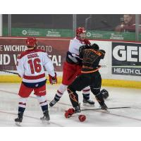 Josh Atkinson of the Allen Americans (white) fights with the Wichita Thunder