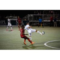 Forward Madison FC forward Mason Toye  shields a Chattanooga Red Wolves SC player