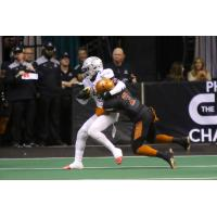 Jamal Miles of the Arizona Rattlers makes a tackle against the San Diego Strike Force