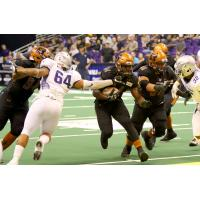 Darrell Monroe of the Arizona Rattlers runs the ball against the San Diego Strike Force