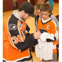 Alex Lyon of the Lehigh Valley Phantoms signing autographs for young fans