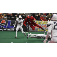 Jacksonville Sharks receiver Jarmon Fortson leaps over a New York Streets defender