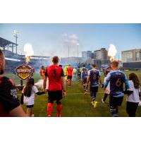 El Paso Locomotive FC and Phoenix Rising FC enter the pitch