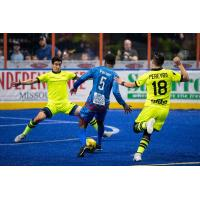 Milwaukee Wave defender Marcio Leite and forward Isaac Pereyra defend against the Kansas City Comets