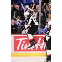 Owen Hardy of the Vancouver Giants jumps against the glass after a goal