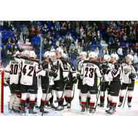 Vancouver Giants exchange congratulations following a win over the Spokane Chiefs