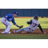 Omar Estevez of the Tulsa Drillers tags out a runner trying to steal second in a 6-4 loss to Arkansas