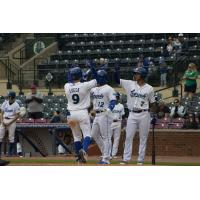 Jackson Lueck of the Lexington Legends receives high fives after his homer