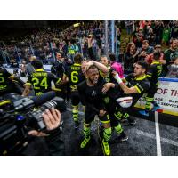 The Milwaukee Wave and Ian Bennett celebrate after clinching a championship berth