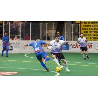Vini Dantas of the Baltimore Blast with possession against the Kansas City Comets