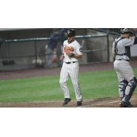 Rey Fuentes crosses home plate for the Long Island Ducks