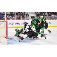 Vancouver Giants pressure Prince Albert Raiders goaltender Ian Scott