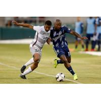 Sacramento Republic FC defender Jordan McCrary (left) against Fresno FC