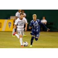 Sacramento Republic FC midfielder Hayden Partain (left) against Fresno FC