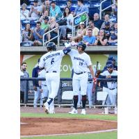 Travis Blankenhorn of the Pensacola Blue Wahoos receives congratulations after a home run