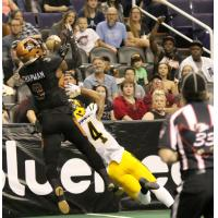 Allen Chapman of the Arizona Rattlers hauls in a pass along the sideline against the Tucson Sugar Skulls