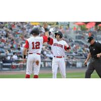 Tyler Wade of the Scranton/Wilkes-Barre Red Barons (RailRiders) receives congratulations at home plate