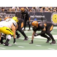 Nikolaus D'Avanzo of the Arizona Rattlers (right) lines up against the Tucson Sugar Skulls